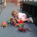 Violette Playing with Dinosaurs at the Library